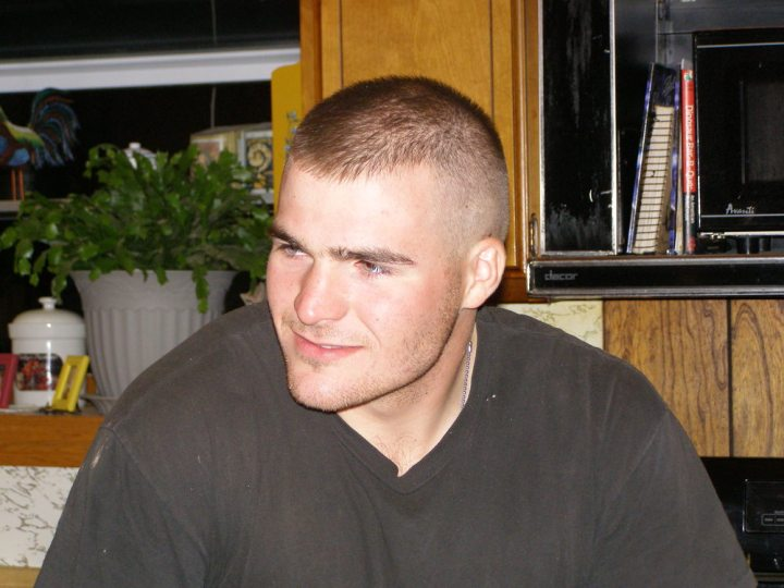 Me at around 19ish (I think). What an Army Nerd! Look at me wearing my dog tags... in civilian clothes, no less!