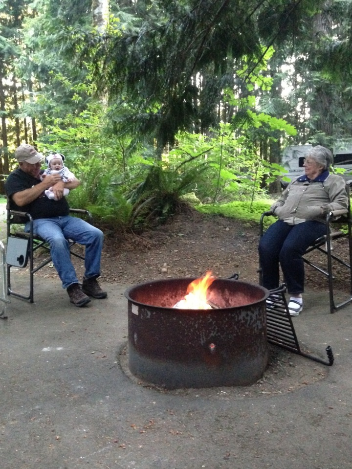 Enjoying the campfire with Grandpa and Great-Grandma. Grandpa had trouble keeping the hat on her head because she likes to pull it off, but we got this picture before she did.