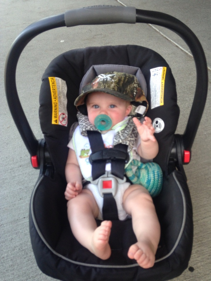 Evie all hatted up in Camo and ready to get this fishing thing ON!