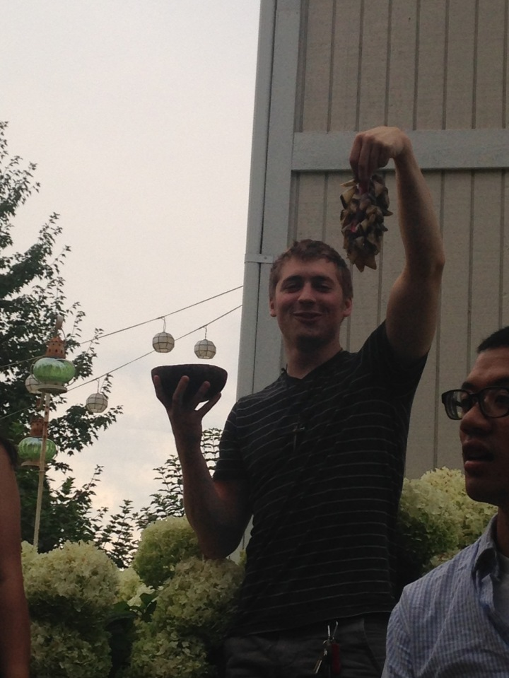 He may look like a young Bacchus, but he is actually a seminarian... and those aren't actually grapes.