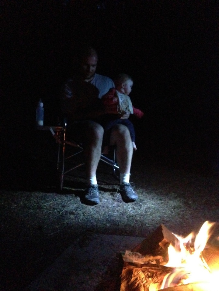 We got a picture of Evie with a Real Fire! Unfortunately, Grandpa was shining his flashlight on us so Mommy could take the picture, and Evie was distracted from the fire by the flashlight.