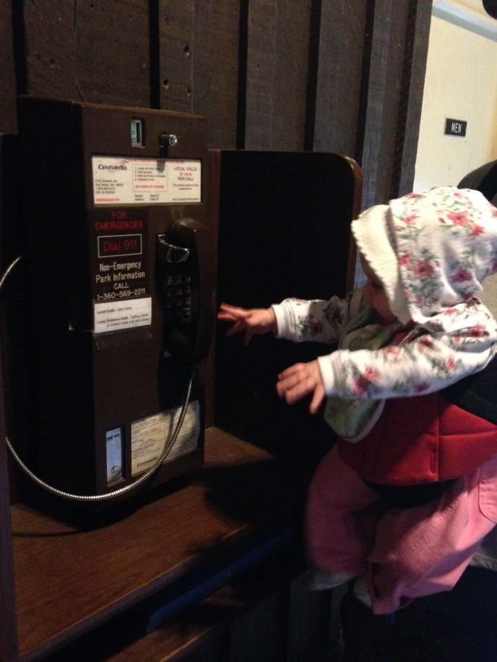 Oh, so that's a payphone? Payphones are tasty, right? Come on, Dad, let me check it out.