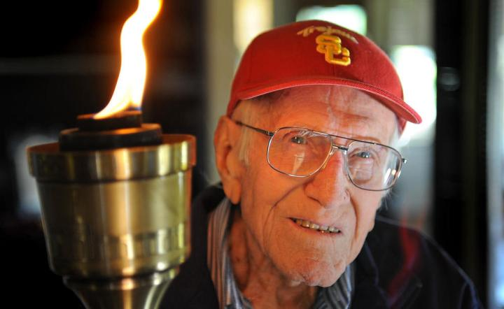 At the age of 82 Louis Zampirin ran the Olympic Torch past one of the former POW camps that he had stayed in.