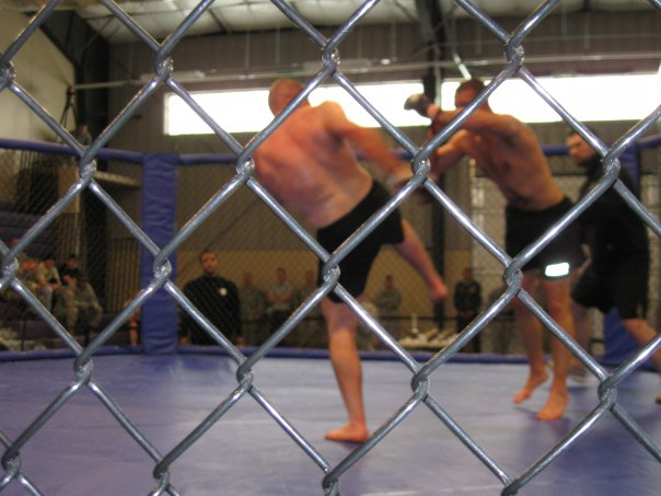 I am the guy throwing the kick. I lost this fight to split decision after three rounds.